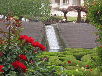 Roses, azalea maze, waterfall, and bougainvillea arbors.