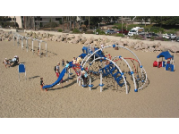 The playground in the sand, as seen from the pier.