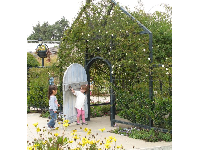 Door kids love to open and close at the Children's Garden.