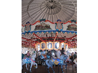 The pale blue carousel, indoors on the pier.