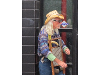 Musician playing a washboard on Telegraph Avenue.