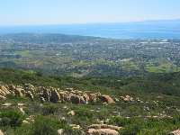 Scattered boulders and birds eye view of Santa Barbara at Playgrounds.