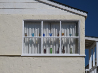Lovely window with colored glass bottles.
