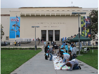 Kids draw outside the museum for a special event.