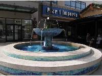Deep blue fountain outside Pier One Imports.
