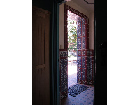 Tiled door leading to the back courtyard.