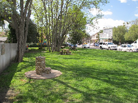 Park with picnic tables on Grand Avenue.