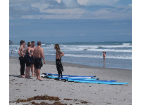 A surf instructor fills students in on what they need to know.
