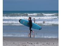 Surf student at Cocoa Beach during Spring Break.