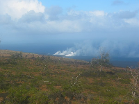 Two plumes rising from where the hot lava met the sea in 2006, seen from Chain of Craters Road.