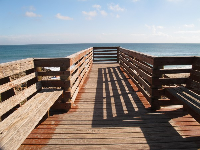 Wooden walkway and stairs leading down to beach.