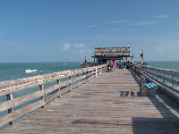 The pier and the blue-green water.