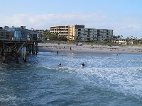 Surfers enjoy the fun waves at Cocoa Beach.