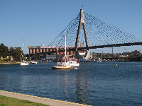 Boats, Anzac bridge, blue water.