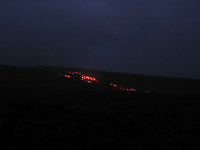 Red lava flowing down the mountain above where we stood.
