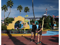 Young couple walking through Suess Landing.