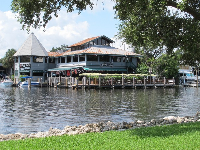 Across the river is Pirate Republic Seafood Grill.