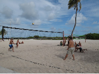Volleyball players alongside the boardwalk.