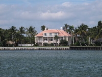 Mansion on the water. Check out the pink roof!