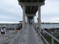 The walkway underneath the causeway, where fishermen hang out.