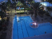 Nighttime swim at Osprey Fountains residence hall pool.