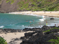 Bodyboarders in the late afternoon at Makapuu Beach.