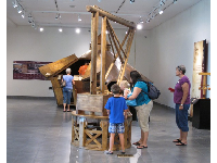 A family enjoys the Da Vinci exhibit (temporary exhibit).