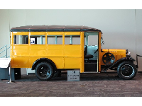 1931 Ford Model AA yellow school bus.