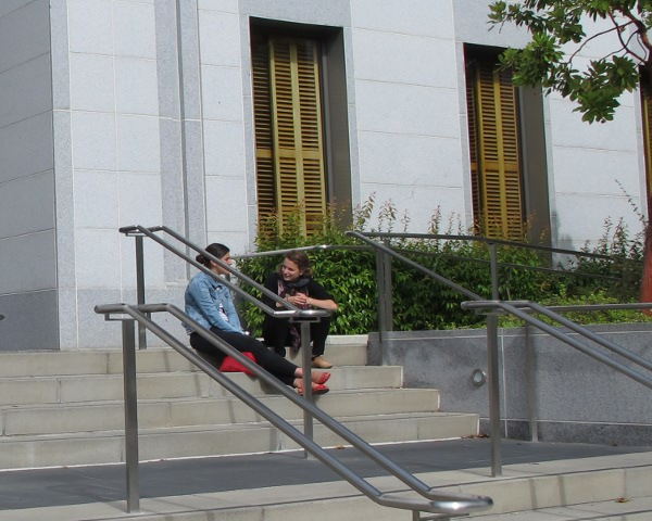 Students sitting on the steps of Stanley Hall, a recent building on campus.