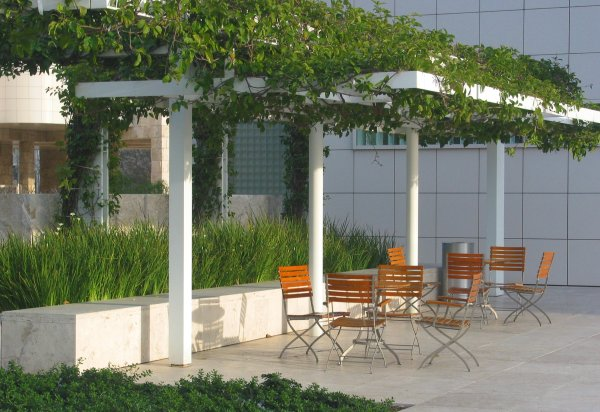 Chairs under a trellis, upstairs near the entrance to the Getty Center.