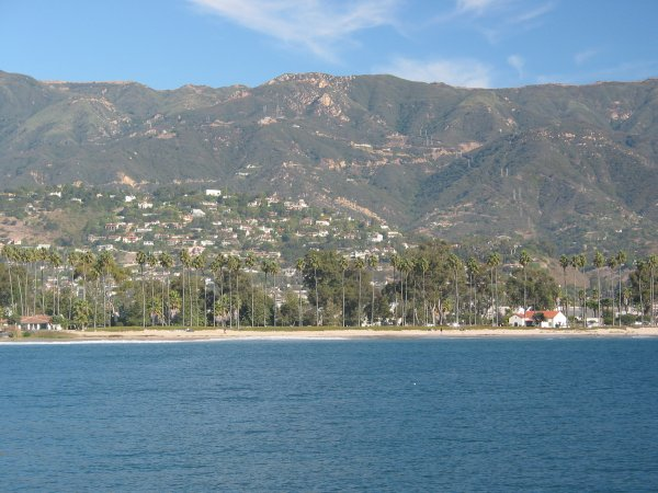 View of the beach and mountains from the pier.