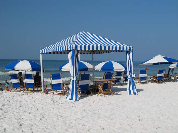 Blue and white striped canopy on the beach.