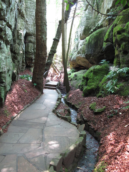 Moss-covered rocks, stream, and pathway.