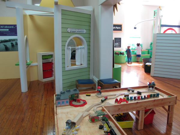 Train set and puppet theater.