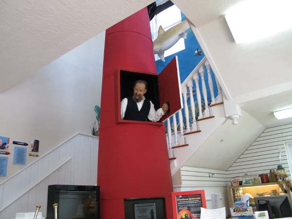 The lighthouse keeper pops out of the lighthouse window and speaks to you!