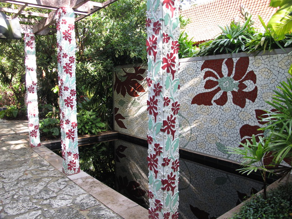 Tropical mosaic pillars and wall.
