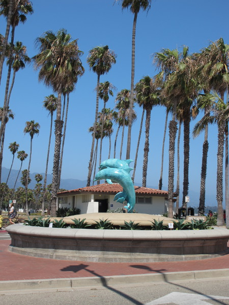 Dolphin statue and palms.
