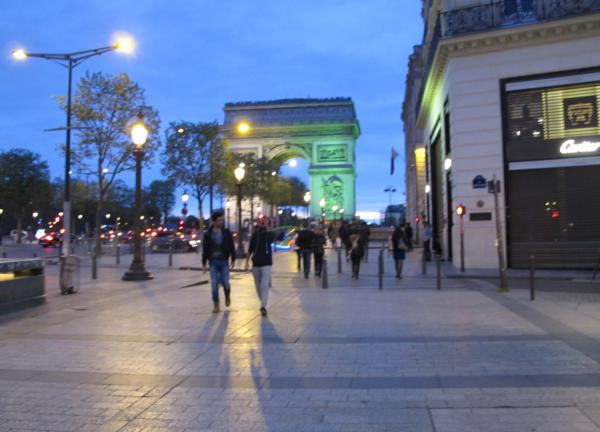 The lit-up Arc de Triomphe, at the northern end of the Champs-Elysee.