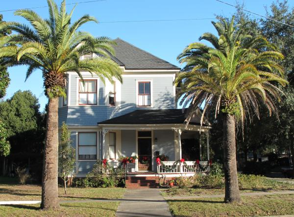 Nice palm trees and historic house.