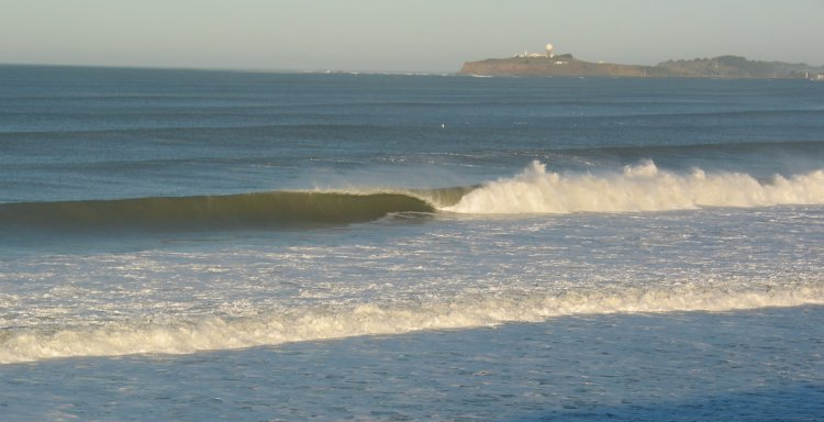 Big tube at Poplar Beach, with Pillar Point (the location of Mavericks) in the background.
