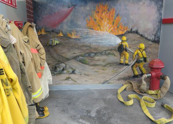 Fire hose and wildfire mural in the fire station.