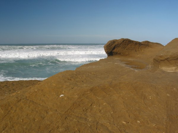 The color of the rock is a striking at Pescadero State Beach.