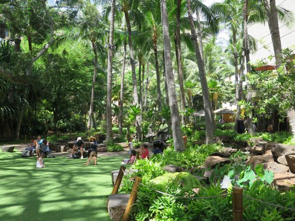 Kids love to play on the lawn in the Royal Hawaiian Center, the shopping center on Kalakaua Ave.