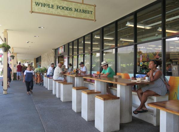 Seating outside Whole Foods Market.