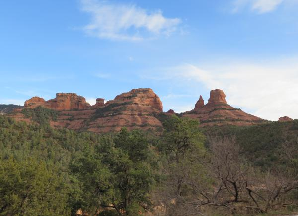 Blue sky and red rock shapes.