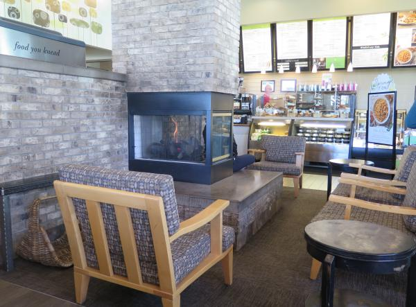 Fireplace and comfy seats at Wildflower Bread Company.