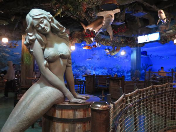 Mermaid sculpture, and sharks hanging from the ceiling.