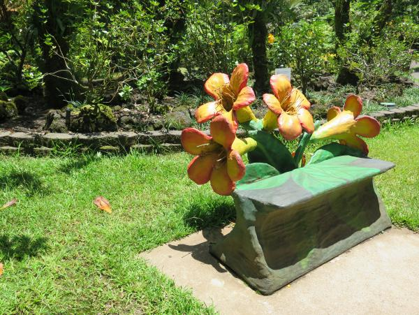Bench with flower sculptures.