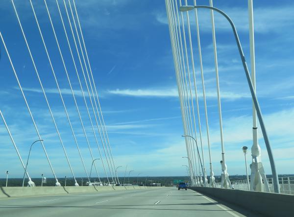 Driving over the bridge on a sunny day.