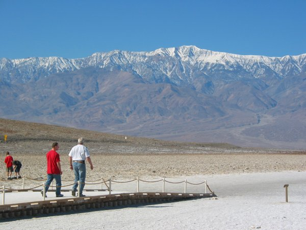 Badwater, with distant snowy Sierra Nevada mountains behind.
